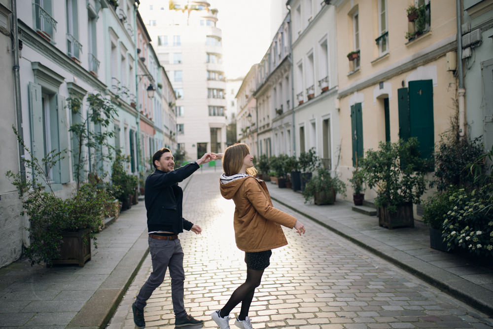 A couple dancing in the streets of Paris at sunrise